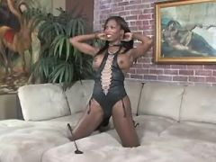 Beautiful ebony tranny gets blowjob from slave guy