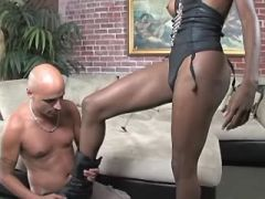 Very playful ebony tranny fucks bald bloke on sofa