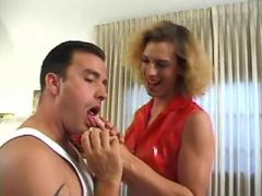 Hot tranny in red and guy suck each other by turns