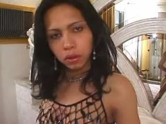 Cute latin shemale in boots plays with her cock