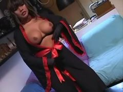 Gorgeous shemale in stockings playing with cock