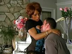 Guy sucks fresh cock of mulatto shemale by piano