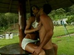 Guy greedily sucks cock of busty shemale outdoor