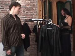 Brunette tgal gets blowjob right in clothing store